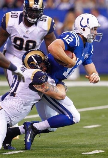INDIANAPOLIS, IN - NOVEMBER 10: Chris Long #91 of the St. Louis Rams makes the sack on Andrew Luck #12 of the Indianapolis Colts at Lucas Oil Stadium on November 10, 2013 in Indianapolis, Indiana. (Photo by Michael Hickey/Getty Images) By Michael Hickey