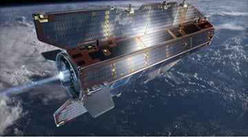 Image provided by European Space Agency (ESA) shows research satellite GOCE flying above Earth / AP PHOTO/EUROPEAN SPACE AGENCY,ESA By European Space Agency (ESA)