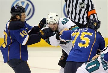 St. Louis Blues Brenden Morrow (L) and Ryan Reaves fight with San Jose Sharks Matt Pelech in the first period at the Scottrade Center in St. Louis on October 15, 2013.    UPI/Bill Greenblatt By BILL GREENBLATT