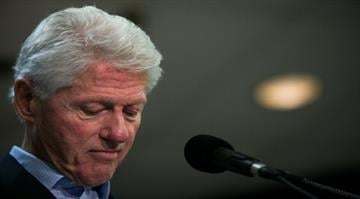 Who's urging Obama to live up to health care promise.  Ex-President Clinton says the law should be changed, if need be, to allow people to keep their insurance if they're happy with it. By Drew Angerer