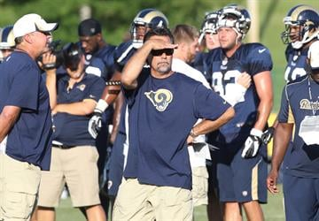 St. Louis Rams head football coach  Jeff Fisher shields his eyes from the afternoon sun during training camp at the team practice facility in Earth City , Missouri on August 1, 2013.   UPI/Bill Greenblatt By BILL GREENBLATT