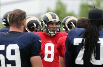 St. Louis Rams quarterback Sam Bradford talks with teammates during training camp at the team practice facility in Earth City , Missouri on July 29, 2013.   UPI/Bill Greenblatt By BILL GREENBLATT