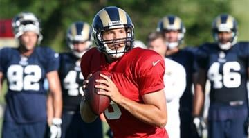 St. Louis Rams quarterback Sam Bradford looks for a open receiver during training camp at the team practice facility in Earth City , Missouri on August 1, 2013.   UPI/Bill Greenblatt By Belo Content KMOV