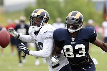 St. Louis Rams Brian Quick (R) battles Darian Stewart for a loose football during training camp at the team practice facility in Earth City , Missouri on July 29, 2013.   UPI/Bill Greenblatt By BILL GREENBLATT