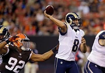 St. Louis Rams quarterback Sam Bradford (8) passes in the grasp of Cleveland Browns defensive tackle Desmond Bryant (92) in the first quarter of a preseason NFL football game, Thursday, Aug. 8, 2013, in Cleveland. (AP Photo/Tony Dejak) By Tony Dejak
