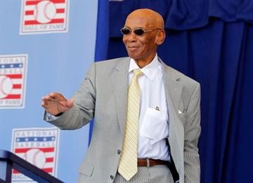 COOPERSTOWN, NY - JULY 22:  Hall of Famer Ernie Banks is introduced at Clark Sports Center during the Baseball Hall of Fame induction ceremony on July 22, 2012 in Cooperstown, New York.  (Photo by Jim McIsaac/Getty Images) By Jim McIsaac