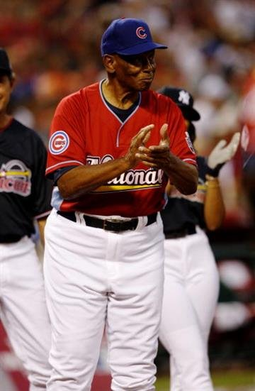 ST. LOUIS - JULY 12: Hall of famer Ernie Banks applauds during the Taco Bell All-Star Legends & Celebrity Softball Game at Busch Stadium on July 12, 2009 in St. Louis, Missouri. (Photo by Dilip Vishwanat/Getty Images) By Dilip Vishwanat