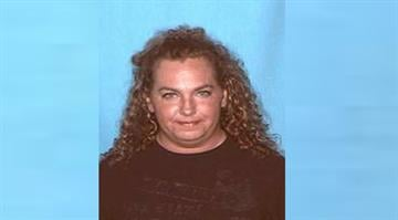 Mary Elizabeth Britt allegedly tried to shoot a neighbor while returning an item she borrowed. By Adam McDonald