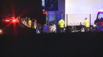 A car crashes and is wedged underneath a tractor trailer. Emergency crews work to help the passengers. By KMOV