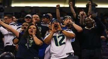 PHOENIX, AZ - JANUARY 27:  Seattle Seahawks fans cheer at Super Bowl XLIX Media Day Fueled by Gatorade inside U.S. Airways Center on January 27, 2015 in Phoenix, Arizona.  (Photo by Elsa/Getty Images) By Elsa