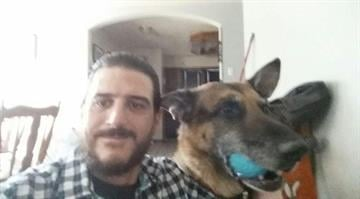 Richard Brower's German Shepherd was stolen from his backyard 18 months ago. His dog, Dozer, popped up on a website for the Claresholm Animal Rescue Society, in Claresholm, Alberta. The pair were reunited in January, 2015. By Courtesy Richard Brower