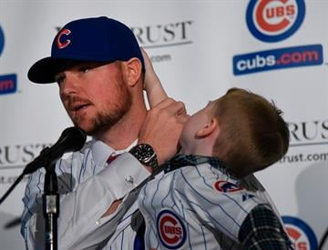 CHICAGO, IL - DECEMBER 15: Jon Lester with his son Hudson at a press conference by the Chicago Cubs on December 15, 2014  in Chicago, Illinois. (Photo by David Banks/Getty Images) By David Banks