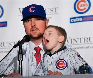 CHICAGO, IL - DECEMBER 15:  Pitcher Jon Lester speaks during an introduction press conference by the Chicago Cubs as his son Hudson sits with him on December 15, 2014  in Chicago, Illinois. (Photo by David Banks/Getty Images) By David Banks