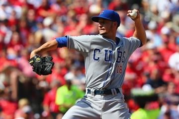 ST. LOUIS, MO - APRIL12: Reliever Chris Rusin #18 of the Chicago Cubs pitches against the St. Louis Cardinals in the fifth inning at Busch Stadium  on April 12, 2014 in St. Louis, Missouri.  (Photo by Dilip Vishwanat/Getty Images) By Dilip Vishwanat