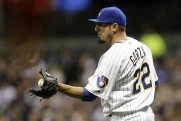 MILWAUKEE, WI - APRIL 14: Matt Garza #22 of the Milwaukee Brewers pitches during the top of the first inning against the St. Louis Cardinals at Miller Park on April 14, 2014 in Milwaukee, Wisconsin. (Photo by Mike McGinnis/Getty Images) By Mike McGinnis