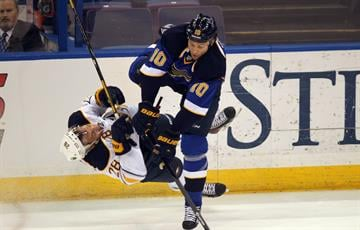 St. Louis Blues Brenden Morrow decks Buffalo Sabres Zemgus Girgensons of Latvia in the first period at the Scottrade Center in St. Louis on April 3, 2014. UPI/Bill Greenblatt By BILL GREENBLATT
