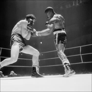 PARIS, FRANCE:  US Rubin Carter (R) lands a punch on Fabio Bettini of Italy during their international middleweight match in Paris, 22 February 1965. Carter beat Bettini by knockout in the 10th round. (Photo credit should read AFP/AFP/Getty Images) By AFP