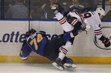 St. Louis Blues T.J. Oshie and Chicago Blackhawks Bryan Bickell collide during the first period of Game 2 of the Western Conference Playoffs at the Scottrade Center in St. Louis on April 19, 2014. UPI/Bill Greenblatt By BILL GREENBLATT