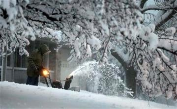 A local resident clears snow from his driveway after an overnight snowfall left many schools and businesses closed for the day, Thursday, Dec. 20, 2012, in Urbandale, Iowa. (AP Photo/Charlie Neibergall) By Charlie Neibergall