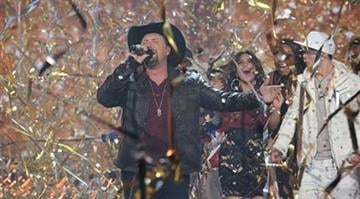 In this Thursday, Dec. 20, 2012 publicity photo released by FOX X FACTOR season two winner Tate Stevens performs during THE X FACTOR Finale Thursday night Dec. 22, 2012 on FOX. (AP Photo/FOX, Ray Mickshaw) By Dan Mueller