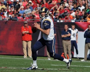 TAMPA, FL - DECEMBER 23: Quarterback Sam Bradford #8 of the St. Louis Rams sets to pass against the Tampa Bay Buccaneers December 23, 2012 at Raymond James Stadium in Tampa, Florida. (Photo by Al Messerschmidt/Getty Images) By Al Messerschmidt