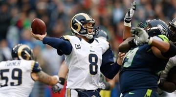 SEATTLE, WA - DECEMBER 30: Quarterback Sam Bradford #8 of the St. Louis Rams passes against the Seattle Seahawks at CenturyLink Field on December 30, 2012 in Seattle, Washington. (Photo by Otto Greule Jr/Getty Images) By Dan Mueller