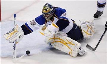 St. Louis Blues goalie Ty Conklin (29) dives on a puck in the first period of an NHL hockey game against the San Jose Sharks in San Jose, Calif., Thursday, Dec. 3, 2009. (AP Photo/Paul Sakuma) By Paul Sakuma