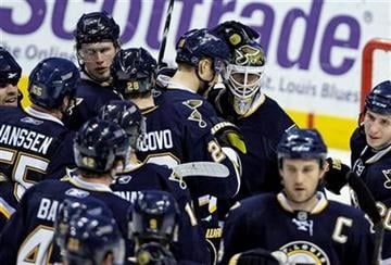 St. Louis Blues goalie Chris Mason is congratulated by teammates after they beat the New York Islanders 4-1 in an NHL hockey game, Saturday, Nov. 21, 2009, in St. Louis. (AP Photo/Tom Gannam) By Tom Gannam