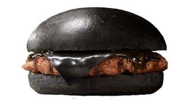 The Kuro Burger comes with a bamboo charcoal bun, beef patties, a black piece of cheese colored by coal and contains black pepper, onion and garlic sauce made from squid ink. By Stephanie Baumer