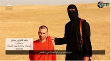 "In an ISIS video titled ""A second message to America"" released September 2, 2014, a masked ISIS figure is shown threatening the life of British captive David Haines. In the same video it shows the beheading of American journalist Steven Sotloff. By SITE"