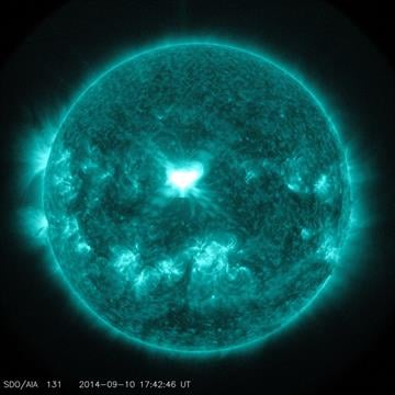 The huge white spot near the center of this picture taken by NASA's Solar Dynamics Observatory shows an X1.6 class solar flare on sun on September 10, 2014. The image shows light in the 131 Angstrom wavelength. By NASA/SDO
