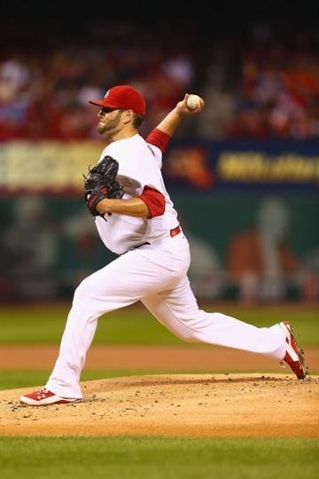 ST. LOUIS, MO - SEPTEMBER 16: Lance Lynn #31 of the St. Louis Cardinals pitches against the Milwaukee Brewers in the first inning at Busch Stadium on September 16, 2014 in St. Louis, Missouri.  (Photo by Dilip Vishwanat/Getty Images) By Dilip Vishwanat