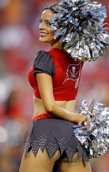 TAMPA, FL - SEPTEMBER 14: A Tampa Bay Buccaneers cheerleader dances during the second half of the game against the St. Louis Rams at Raymond James Stadium on September 14, 2014 in Tampa, Florida. (Photo by Scott Iskowitz/Getty Images) By Scott Iskowitz