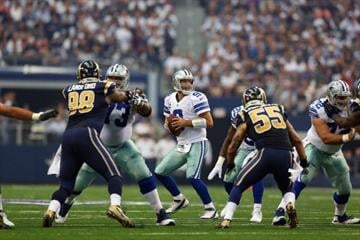 ARLINGTON, TX - SEPTEMBER 22:  Tony Romo #9 of the Dallas Cowboys throws against the St. Louis Rams at AT&T Stadium on September 22, 2013 in Arlington, Texas.  (Photo by Ronald Martinez/Getty Images) By Ronald Martinez