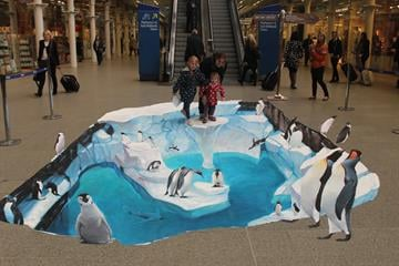 [4/4] Shoppers get to take part in this 3D art in a shopping mall advertising for SeaWorld. By From Street Advertising Services