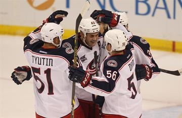 Columbus Blue Jackets Jared Boll (40) celebrates a goal with Marko Dano (56) in the first period against the St. Louis Blues at the Scottrade Center in St. Louis on September 25, 2014. UPI/BIll Greenblatt By BILL GREENBLATT
