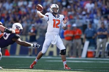 SEATTLE, WA - SEPTEMBER 13: Quarterback Wes Lunt #12 of the Illinois Fighting Illini passes against the Washington Huskies on September 13, 2014 at Husky Stadium in Seattle, Washington. (Photo by Otto Greule Jr/Getty Images) By Otto Greule Jr