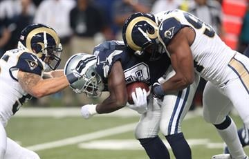 Dallas Cowboys DeMarco Murray is stopped by St. Louis Rams James Laurinaitis (L) and Robert Quinn in the second quarter at the Edward Jones Dome in St. Louis on September 21, 2014. Dallas won the game 34-31.  UPI/Bill Greenblatt By BILL GREENBLATT