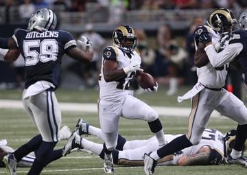 St. Louis Rams Trey Watts runs through a hole in the first quarter against the Dallas Cowboys at the Edward Jones Dome in St. Louis on September 21, 2014. UPI/Bill Greenblatt By BILL GREENBLATT