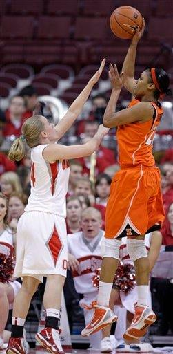 Illinois' Lacey Simpson, right shoots over Ohio State's Maria Moeller during the second half of an NCAA college basketball game Thursday, Jan. 14, 2010, in Columbus, Ohio. Ohio State beat Illinois 72-61. (AP Photo/Jay LaPrete) By Jay LaPrete