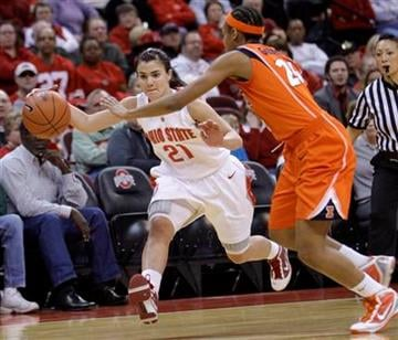 Ohio State's Samantha Prahalis, left, drives to the basket against Illinois' Adrienne Godbold during the first half of an NCAA college basketball game Thursday, Jan. 14, 2010, in Columbus, Ohio. (AP Photo/Jay LaPrete) By Jay LaPrete