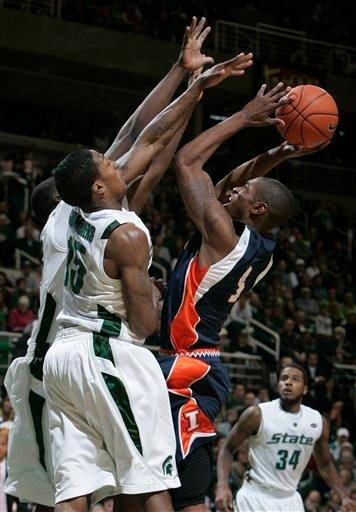 Illinois' Brandon Paul, right, shoots as Michigan State's Durrell Summers (15) and Draymond Green defend during the first half of an NCAA college basketball game, Saturday, Jan. 16, 2010, in East Lansing, Mich. (AP Photo/Al Goldis) By Al Goldis
