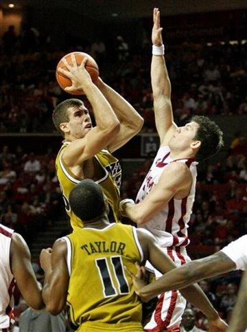 Missouri forward Justin Safford, left, shoots as Oklahoma guard Cade Davis, right, defends during the first half of an NCAA basketball game in Norman, Okla., on Saturday, Jan. 16, 2010.   (AP Photo/Alonzo Adams) By Alonzo Adams