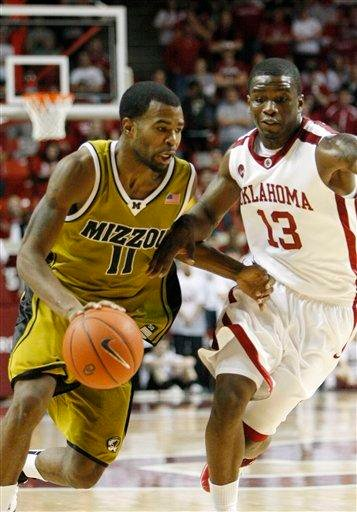 Missouri guard Zaire Taylor (11) drives to the basket as Oklahoma guard Willie Warren (13) defends during the first half of an NCAA basketball game in Norman, Okla. on Saturday, Jan. 16, 2010.   (AP Photo/Alonzo Adams) By Alonzo Adams