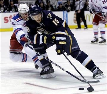 St. Louis Blues' Jay McClement (18) and New York Rangers' Michael Del Zotto chase a loose puck during the second period of an NHL hockey game Saturday, Jan. 16, 2010, in St. Louis. The Blues won 1-0. (AP Photo/Jeff Roberson) By Jeff Roberson
