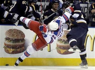 New York Rangers' Ryan Callahan, left, goes flying after colliding with St. Louis Blues' T.J. Oshie, right, during the first period of an NHL hockey game Saturday, Jan. 16, 2010, in St. Louis.  (AP Photo/Jeff Roberson) By Jeff Roberson