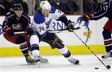St. Louis Blues' T.J. Oshie, right, carries the puck across the blue line as Columbus Blue Jackets' Kris Russell defends during the first period of an NHL hockey game Monday, Jan. 18, 2010, in Columbus, Ohio. (AP Photo/Jay LaPrete) By Jay LaPrete