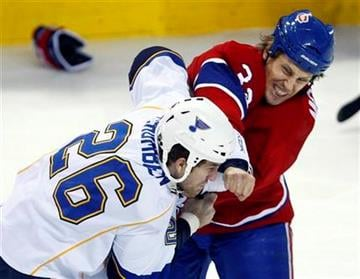 Montreal Canadiens' Travis Moen and  St. Louis Blues' B.J. Crombeen fight during the first period of an  NHL hockey game on Wednesday, Jan.  20, 2010 in Montreal.   (AP Photo/The Canadian Press,Paul Chiasson) By Paul Chiasson