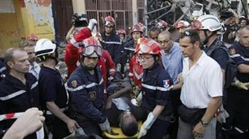 A 23-year-old man is rescued by a French search and rescue team after being trapped in the rubble of a fruit and vegetable shop for 11 days after the massive earthquake in Port-au-Prince, Saturday, Jan. 23, 2010. By Gregory Bull