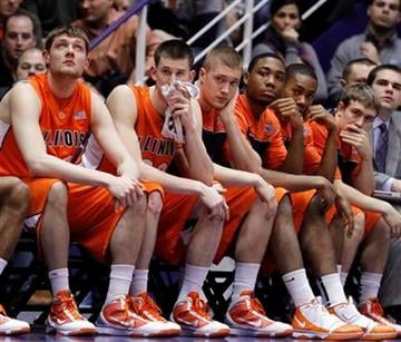 Illinois players react as they watch their teammates play against Northwestern during the second half of an NCAA college men's basketball game in Evanston, Ill., Saturday, Jan. 23, 2010. Northwestern won 73-68.(AP Photo/Nam Y. Huh) By Nam Y. Huh